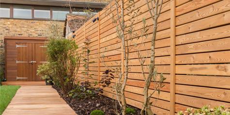 Деревянные заборы из планкена фото